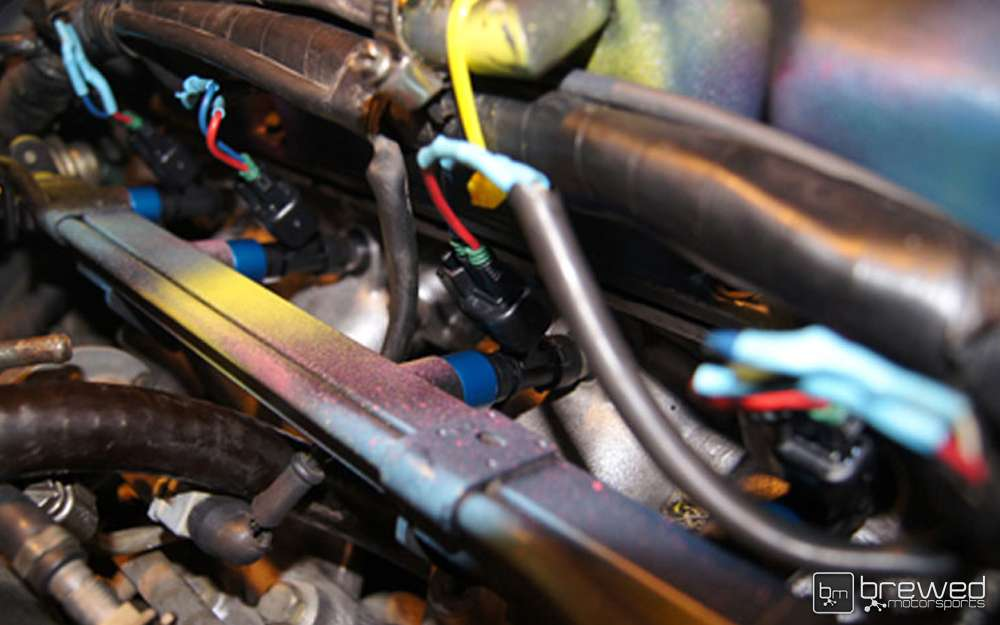 attach injector clips to fuel injectors